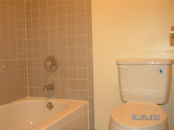 second part of master bath has toilet and tub/shower